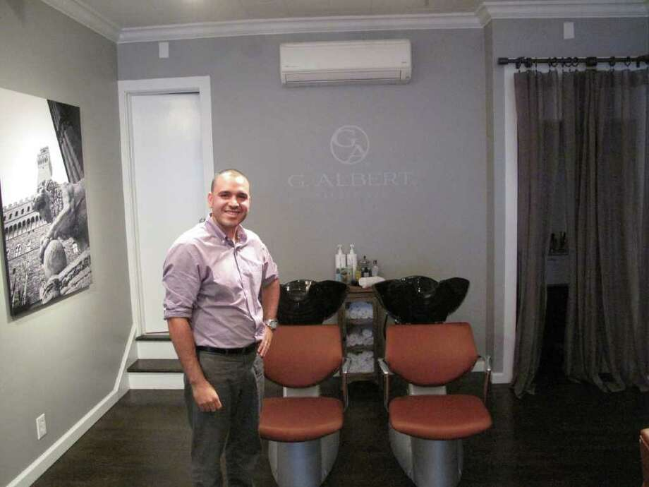 Owner Albert Gonzalez stands proudly inside his new Barper Spa called G. Albert on Elm Street. Photo: Paresh Jha