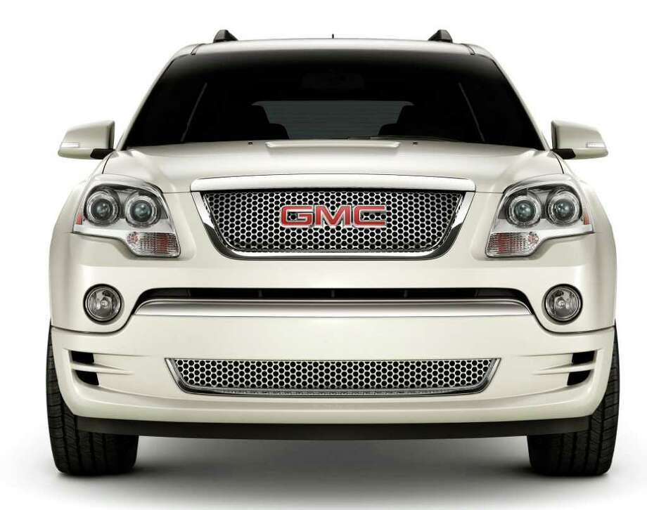 The Acadia Denali comes with the signature chrome honeycomb grille that GMC also uses on Denali models of the Yukon SUV and Sierra pickups. COURTESY OF GENERAL MOTORS CO. Photo: General Motors, COURTESY OF GENERAL MOTORS CO. / GMC