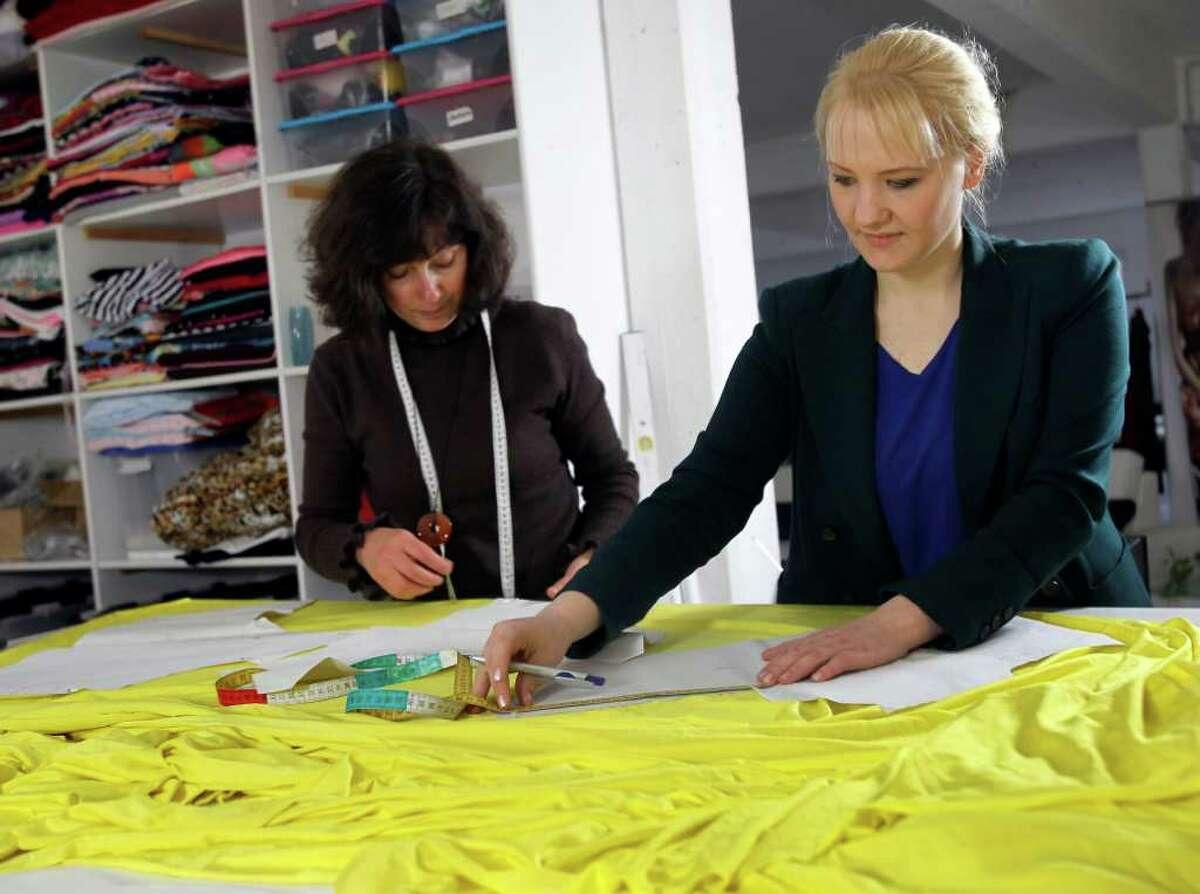 Fashion designer Anke Domaske (right) and seamstress Tatjana Berthold work at their studio in Hanover, Germany.