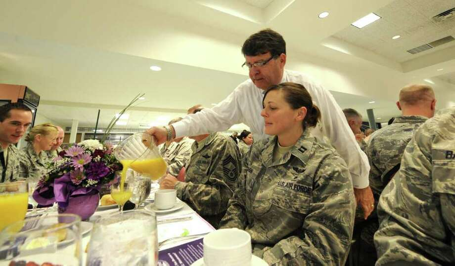 F. Michael Tucker of the Center for Economic Growth was a guest server at  The Chamber of Schenectady County's community breakfast in honor of these who have served and are currently serving in the armed forces at the Stratton Air National Guard facility in Scotia, N.Y. November 15, 2011.  (Skip Dickstein/Times Union) Photo: Skip Dickstein / 2011