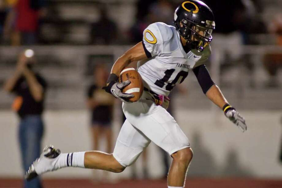 NATHAN LINDSTROM: FOR THE CHRONICLE TAKING OFF: Klein Oak wide receiver Tuff McClain runs in a touchdown against Westfield earlier this season. The Panthers next host Austin Westlake Saturday. Photo: Nathan Lindstrom / ©2011 Nathan Lindstrom