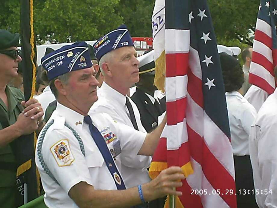 COURTESY MILITARY ORDER OF THE PURPLE HEART PATRIOTISM ON PARADE: Stephen McGrew, center left, and Mike Donnelly, center right, march in the Memorial Day Parade at the Houston National Cemetery in 2005. McGrew and Donnelly were wounded in Vietnam and are active members of the Katy chapter of the Military Order of the Purple Heart.