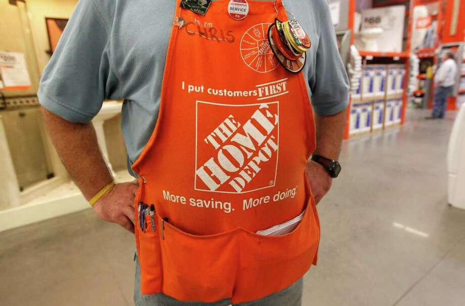 An employee at the Home Depot wears an apron in Irving, Texas,  Monday, Nov. 14, 2011. Spending on home projects and storm-related repairs helped boost Home Depot Inc.'s third-quarter net income 12 percent, the home-improvement retailer said Tuesday, Nov. 15, 2011. (AP Photo/LM Otero) Photo: LM Otero