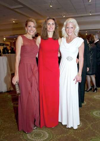 "Chairs of the ""Casablanca"" Gala for Greenwich Hospital to benefit the Cancer Institute Aundrea Amine, Anne Juge and Sabrina Forsythe get together at the sold-out event, which was held recently at the Greenwich Country Club. Photo: Elaine Ubina/Contributed Photo / Greenwich Citizen"