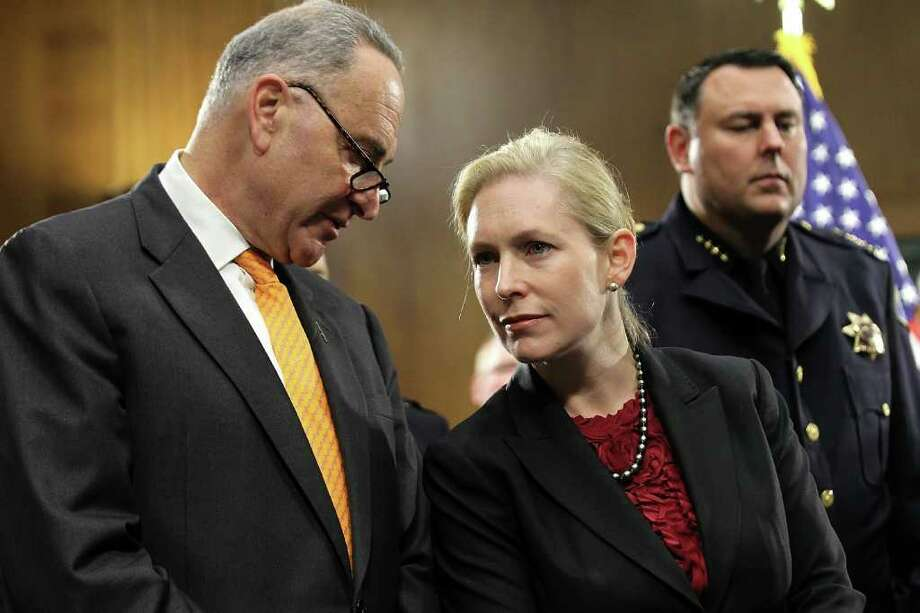 WASHINGTON, DC - NOVEMBER 15:  U.S. Sen. Kirsten Gillibrand (D-NY) (C) listens to Sen. Charles Schumer (D-NY) (L) during a news conference November 15, 2011 on Capitol Hill in Washington, DC. The news conference was to call for the Joint Select Committee on Deficit Reduction, also known as the Supercommittee, to include legislation to provide first responders and public safety officials with better communications network.  (Photo by Alex Wong/Getty Images) Photo: Alex Wong