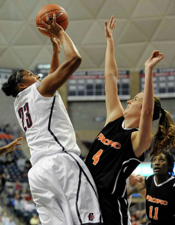 Connecticut's Kaleena Mosqueda-Lewis, left, goes up for a shot while guarded by Pacific's Kendall Rodriguez in the first half of an NCAA college basketball game Storrs, Conn., Tuesday, Nov. 15, 2011. (AP Photo/Jessica Hill) Photo: Jessica Hill/Associated Press / AP2011