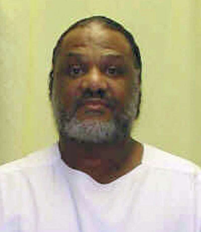 FILE - This file photo provided by the Ohio Department of Rehabilitation and Correction shows Reginald Brooks, who  is scheduled to be put to death Tuesday, Nov. 15, 2011, for fatally shooting his three sons while they slept in 1982, shortly after his wife filed for divorce. Brooks, 66, of East Cleveland, would be the oldest person put to death in Ohio and the first executed by the state in nearly six months. (AP Photo/File-Ohio Department of Rehabilitation and Correction, File) Photo: Anonymous