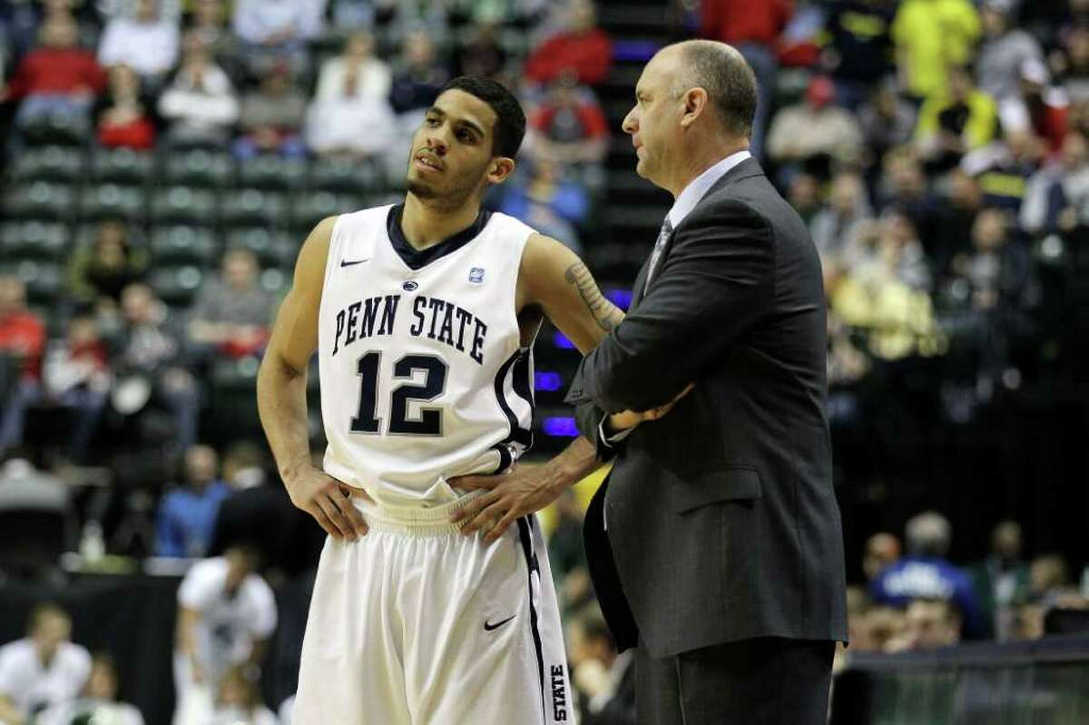 INDIANAPOLIS, IN - MARCH 12: Head coach Ed DeChellis and Talor Battle #12 of the Penn State Nittany Lions talk on the sideline against the Michigan State Spartans during the semifinals of the 2011 Big Ten Men's Basketball Tournament at Conseco Fieldhouse on March 12, 2011 in Indianapolis, Indiana. Penn State won 61-48. (Photo by Andy Lyons/Getty Images) *** Local Caption *** Ed DeChellis;Talor Battle