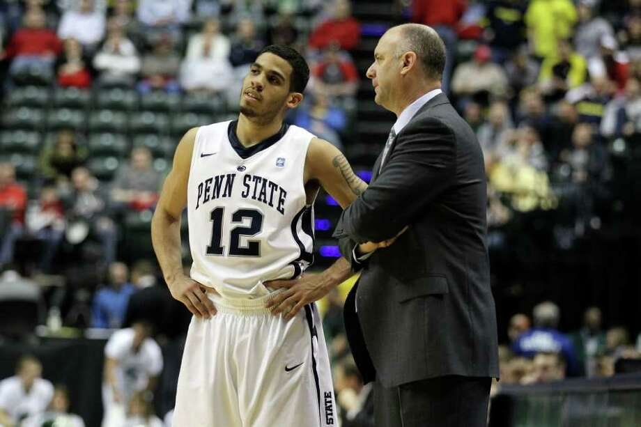 INDIANAPOLIS, IN - MARCH 12:  Head coach Ed DeChellis and Talor Battle #12 of the Penn State Nittany Lions talk on the sideline against the Michigan State Spartans during the semifinals of the 2011 Big Ten Men's Basketball Tournament at Conseco Fieldhouse on March 12, 2011 in Indianapolis, Indiana. Penn State won 61-48. (Photo by Andy Lyons/Getty Images) *** Local Caption *** Ed DeChellis;Talor Battle Photo: Andy Lyons / 2011 Getty Images