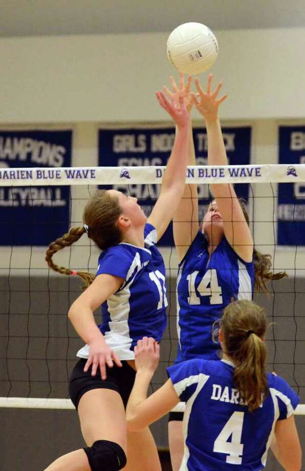 Darien's Katie Stueber (11) pops the ball up over Glastonbury's Emily Grusse (14) for a point during the girls volleyball state tournament Class LL quarterfinals at Darien High School on Tuesday, Nov. 15, 2011. Photo: Amy Mortensen / Connecticut Post Freelance