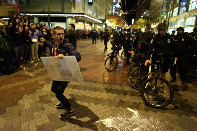 A protester mocks Seattle Police during an Occupy Seattle protest on Tuesday, November 15, 2011 at Westlake Park. Photo: JOSHUA TRUJILLO / SEATTLEPI.COM