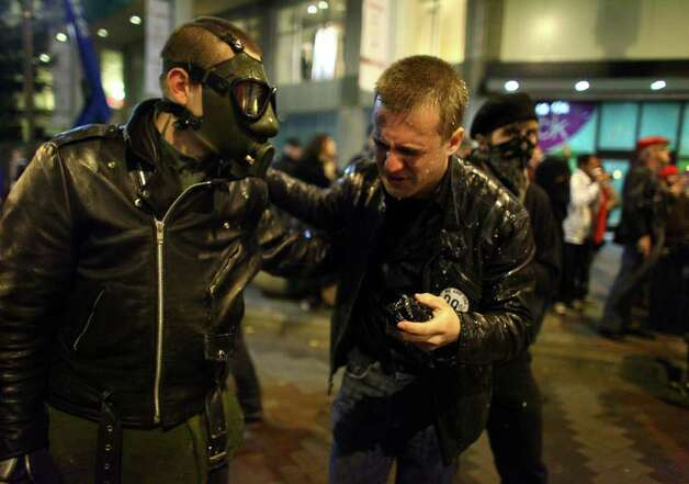 Protesters react after Seattle Police officers deployed pepper spray into a crowd during an Occupy Seattle protest on Tuesday, November 15, 2011 at Westlake Park. Protesters gathered in the intersection of 5th Avenue and Pine Street after marching from their camp at Seattle Central Community College in support of Occupy Wall Street. Photo: JOSHUA TRUJILLO / SEATTLEPI.COM