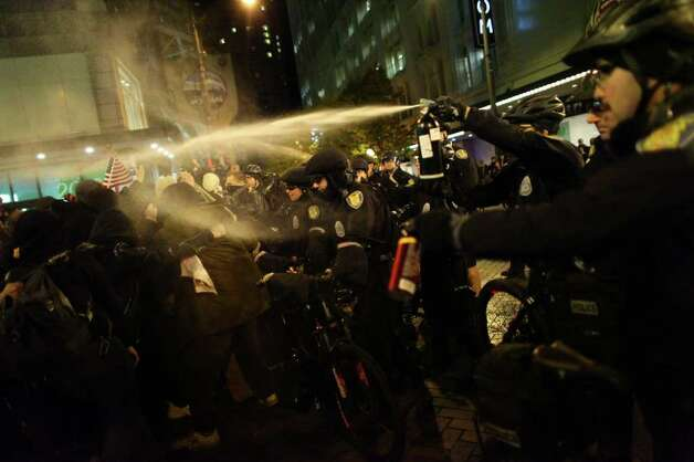 Seattle Police officers deploy pepper spray into a crowd during an Occupy Seattle protest on Tuesday, November 15, 2011 at Westlake Park. Photo: JOSHUA TRUJILLO / SEATTLEPI.COM