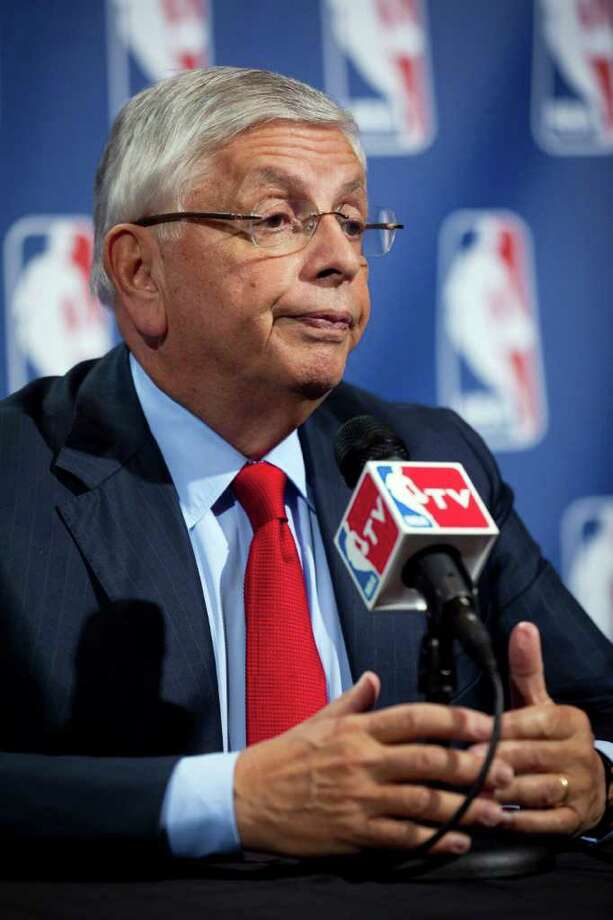 NBA commissioner David Stern speaks during a news conference Thursday, Nov. 10, 2011, in New York. The NBA and its players are hitting pause in their negotiations as the union considers the league's latest revised offer.The league offered a revised offer after nearly 11 hours of bargaining Thursday. It's based on the possibility of a 72-game season, starting Dec. 15. (AP Photo/John Minchillo) Photo: John Minchillo / FR170537 AP