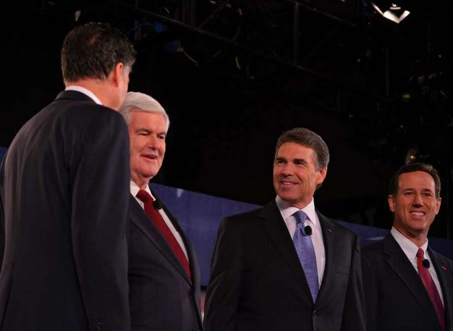 In this Saturday, Nov. 12, 2011 photo, from left to right, GOP presidential candidates former Massachusetts Gov. Mitt Romney, former Speaker of the House Newt Gingrich, Texas Gov. Rick Perry and former U.S. Sen. Rick Santorum stand at the CBS News/National Journal foreign policy debate at the Benjamin Johnson Arena, in Spartanburg, S.C. (AP Photo/The Spartanburg Herald-Journal, Tim Kimzey) Photo: Tim Kimzey