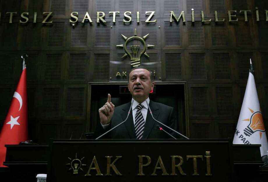"Turkey's Prime Minister Recep Tayyip Erdogan gestures while addressing members of Parliament from his ruling AK Party during a meeting at the parliament in Ankara, on November 15, 2011. Turkey does not expect anymore Syria to respond to the demands of the international community to stop violence and initiate democratic reforms, Prime Minister Recep Tayyip Erdogan said on November 15. ""It is not among our expectations anymore that the government of Assad would demonstrate the desired leadership, which is honest, persuasive, brave and determined... No one expects him anymore to respond to the demands of the international community,"" Erdogan told his lawmakers in the parliament. AFP PHOTO/ADEM ALTAN (Photo credit should read ADEM ALTAN/AFP/Getty Images) Photo: ADEM ALTAN"