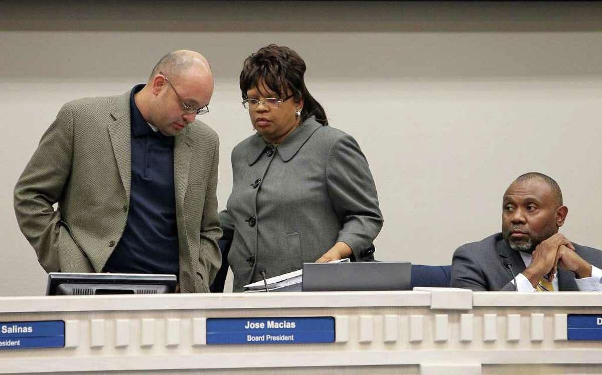 Ousted Judson school board president Jose Macias (left) gave up his seat Tuesday to new president June Adair.