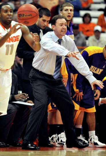 Albany head coach Will Brown yells to his players during the first half against Syracuse in the NIT