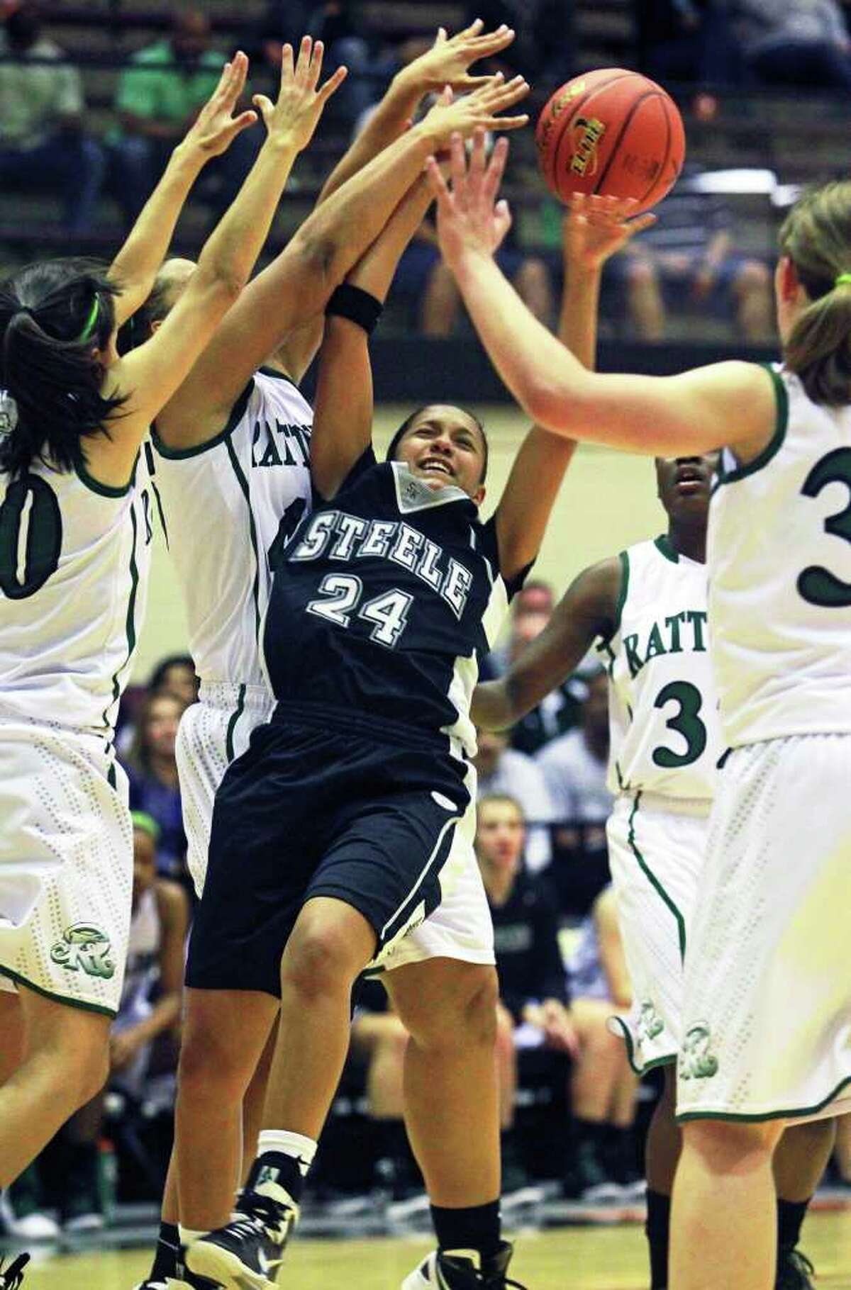 SPORTS Steele's Elena Gumbs draws a foul as the Reagan defense collapses on her drive to the bucket as Reagan plays Steele in girls basketball at Littleton Gym on November 15, 2011. Tom Reel/Staff
