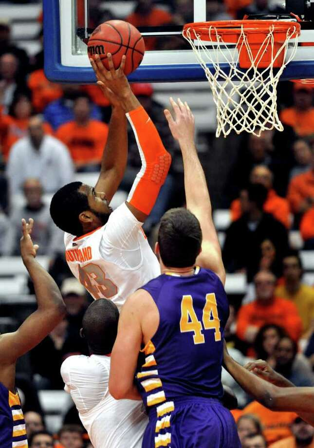 Syracuse's James Southerland scores against Albany during the first half of the NIT Season Tip-Off NCAA college basketball game in Syracuse, N.Y., Tuesday, Nov. 15, 2011. (AP Photo/Kevin Rivoli) Photo: Kevin Rivoli
