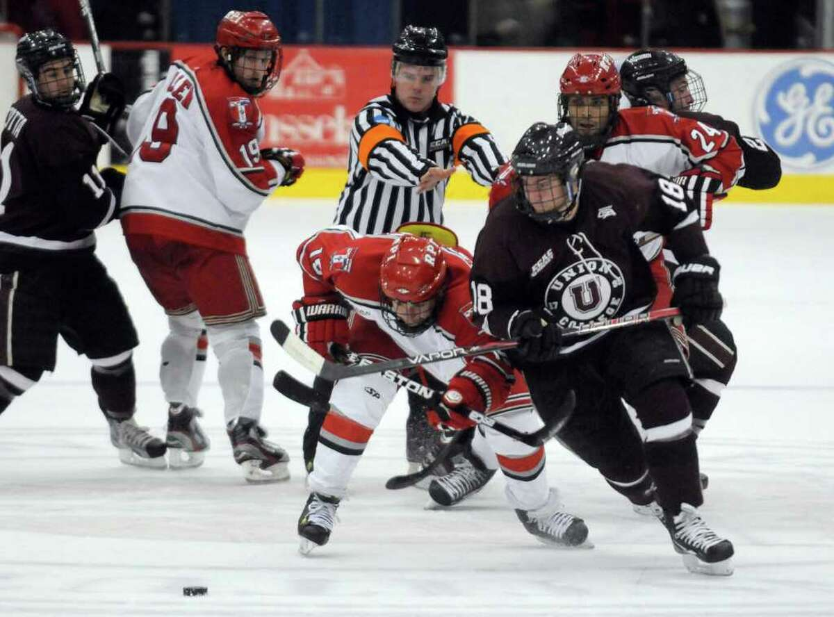 Union's Max Novak,right, and RPI's Jacob Laliberte battle for the puck during their college hockey game at the Houston Field House Troy, NY Tuesday, Nov.15, 2011.( Michael P. Farrell/Times Union)