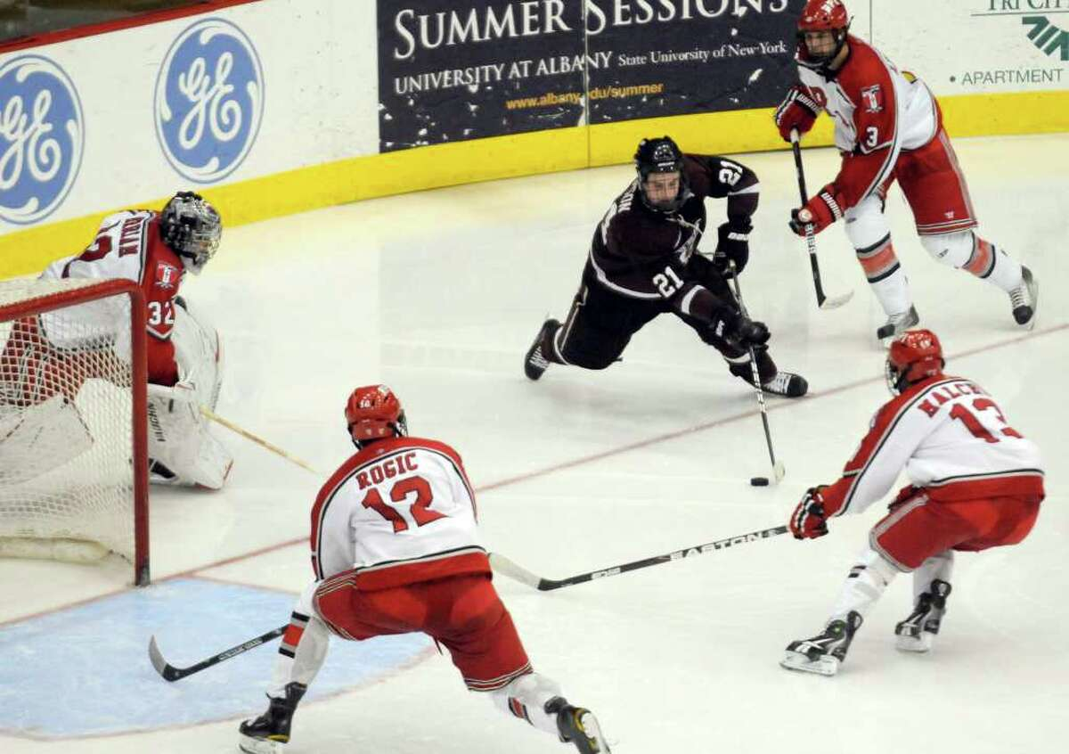 Union's Wayne Simpson looks for a shot against RPI defenders during their college hockey game at the Houston Field House Troy, NY Tuesday, Nov.15, 2011.( Michael P. Farrell/Times Union)