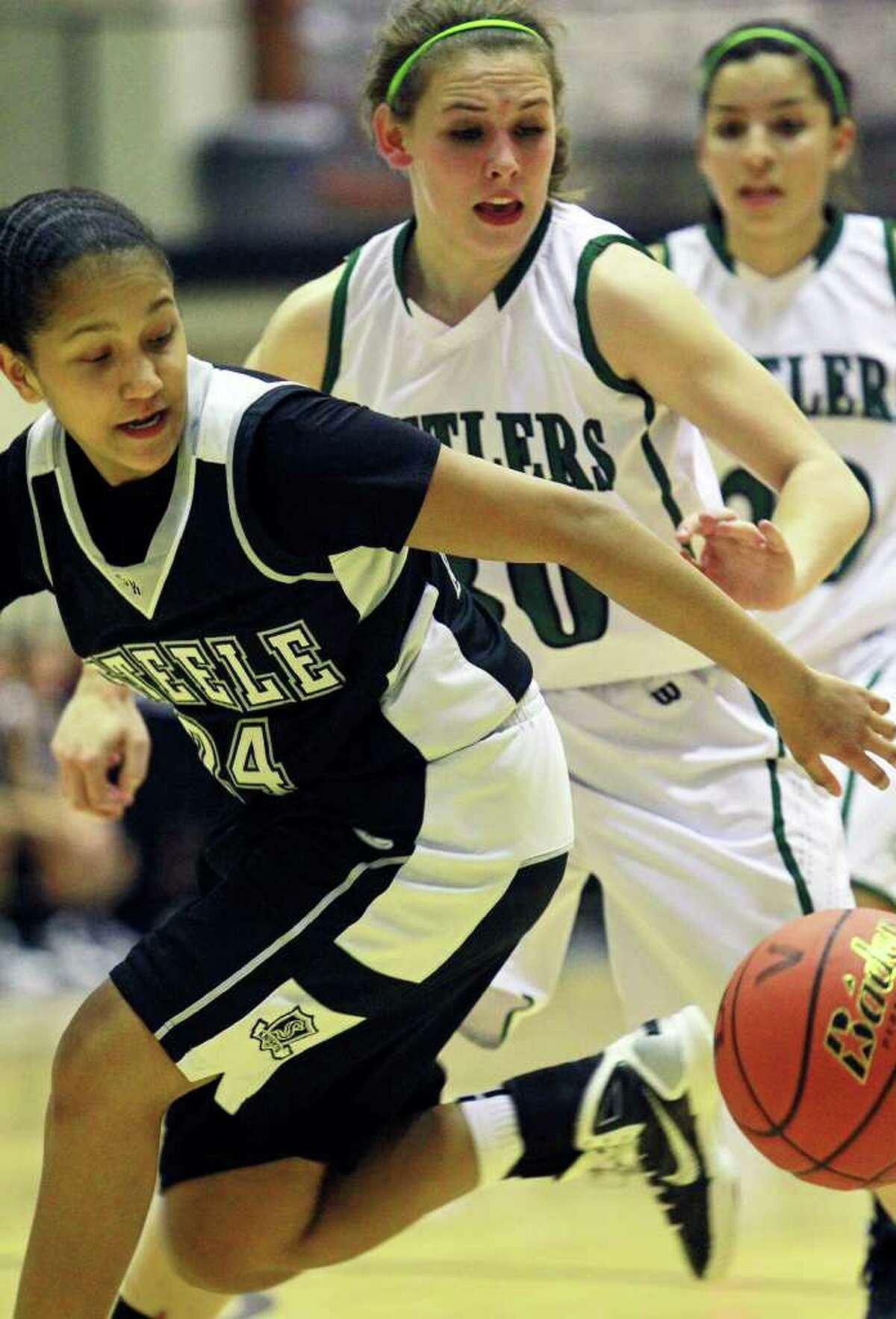 SPORTS Steele's Elena Gumbs loses the ball on a drive with pressure applied by Reagan's Malorie Dyer as Reagan plays Steele in girls basketball at Littleton Gym on November 15, 2011. Tom Reel/Staff