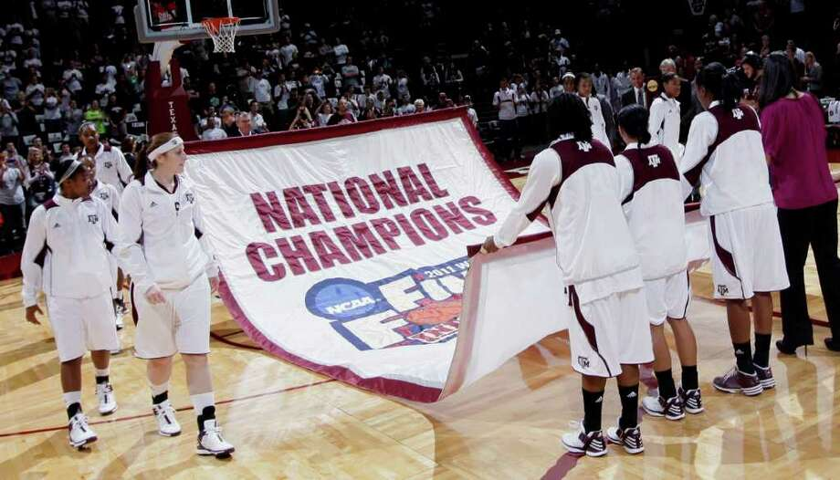 PERMANENT RECOGNITION: It was a banner day for Texas A&M on Tuesday at Reed Arena. Photo: David J. Phillip / Copyright: AP