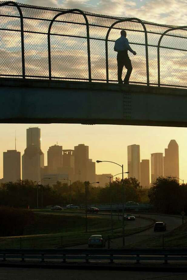 A runner uses a footbridge parallel to Jackson Hill Street to cross over Memorial Drive Wednesday, Nov. 16, 2011, in Houston. (Cody Duty / Houston Chronicle) Photo: Cody Duty / © 2011 Houston Chronicle
