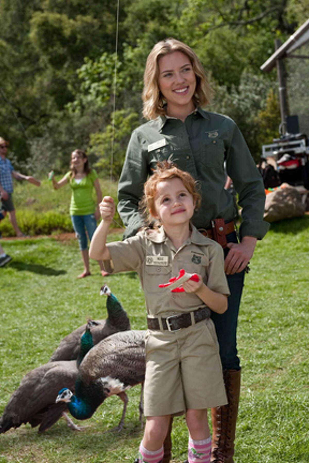 Scarlett Johansson (top) as Kelly Foster and Elizabeth Jones as Rosie Mees in