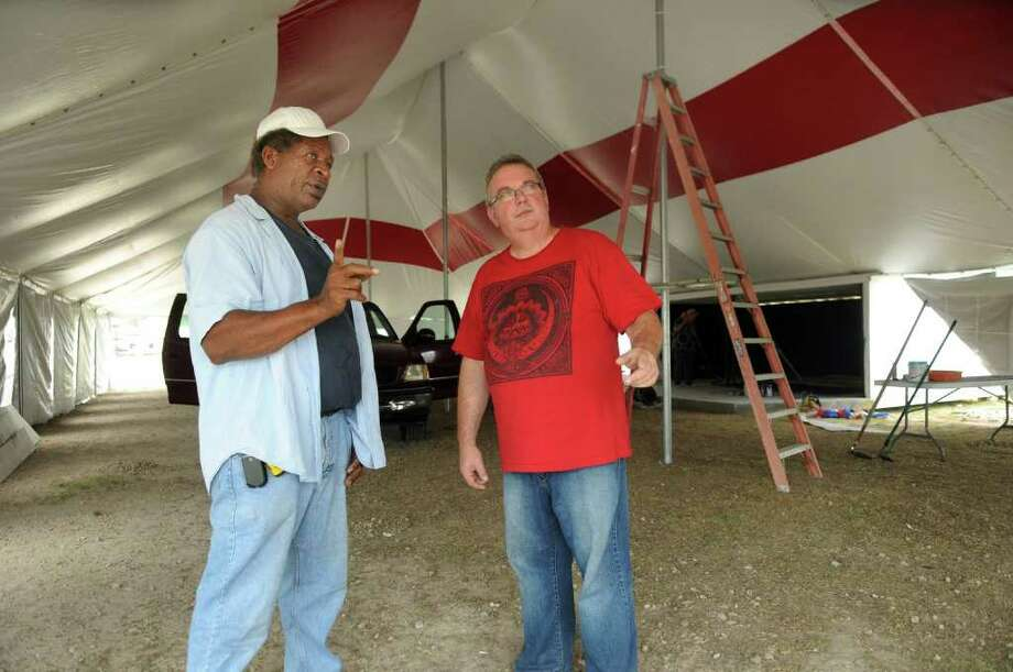 JERRY BAKER PHOTOS: FOR THE CHRONICLE EVERYONE IS WELCOME: Emery Allen, left, of Dickinson and Pastor Bart Dye of Lifehouse Community Church discuss the layout for their big tent revival at the corner of FM 2920 and Falvel in Spring. Photo: Jerry Baker