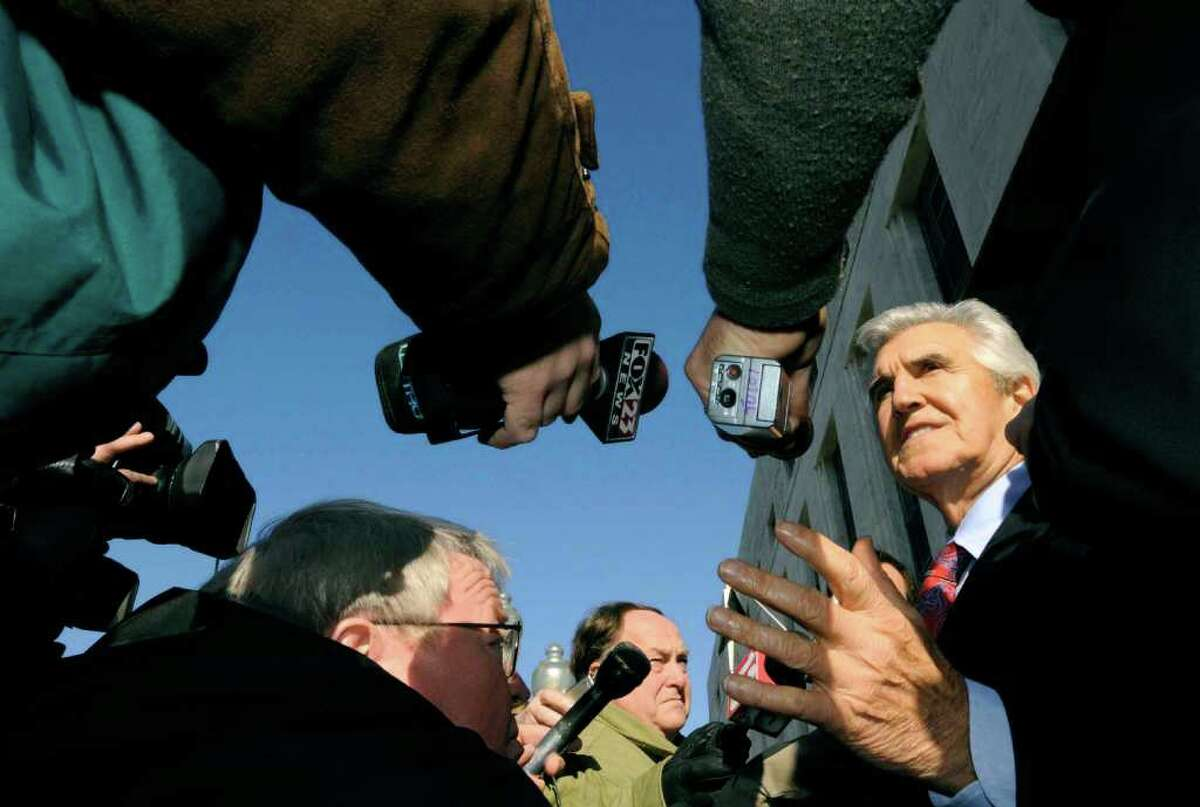 Former State Senator Joseph Bruno, right, speaks to the media outside the Federal court house during a brake in his trial in Albany, New York 11/18/2009. (Michael P. Farrell/Albany Times Union)