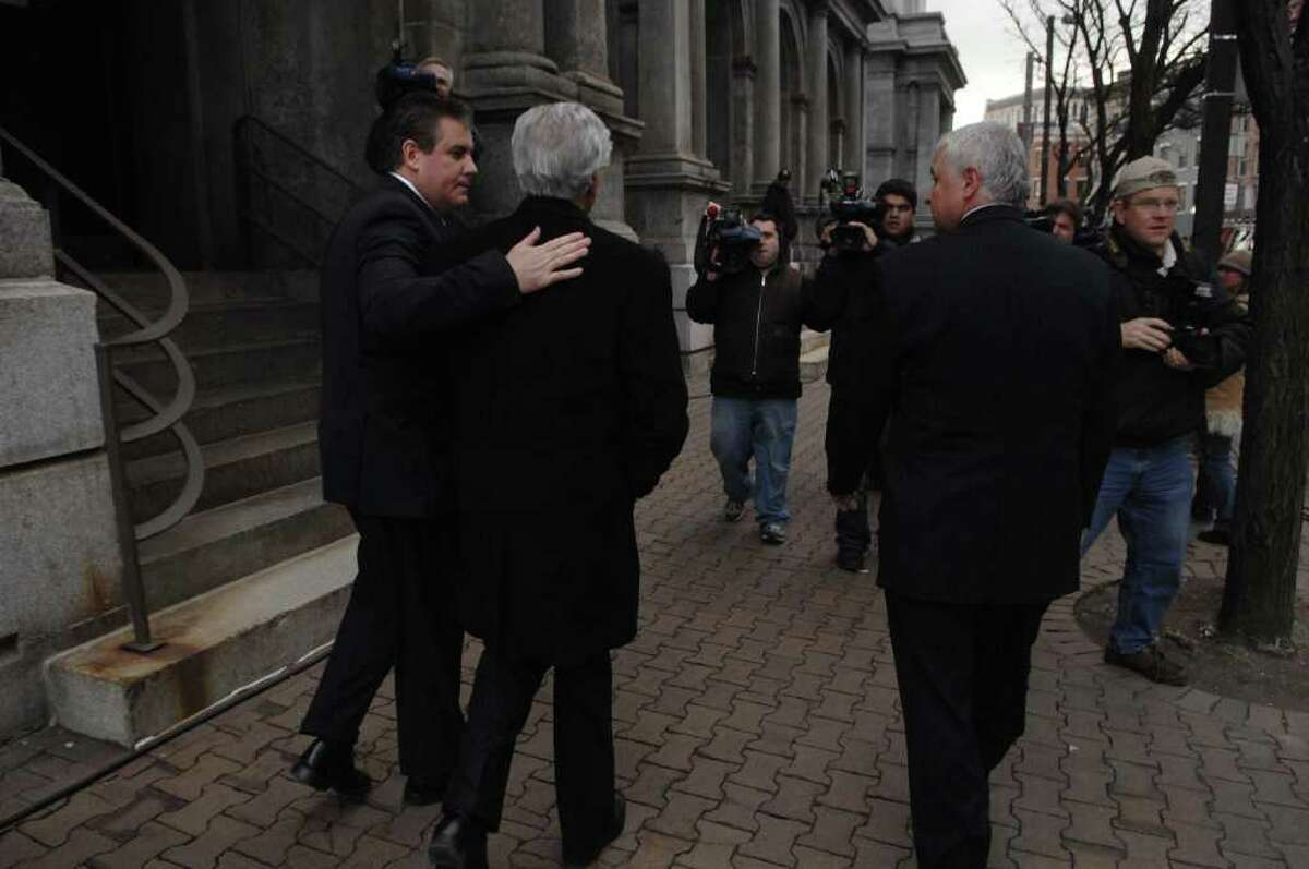 Ken Bruno, left, places his arm around his father, Ex-state senator Joseph Bruno, as the two left the Federal Courthouse in Albany, NY on Tuesday late afternoon, Dec. 1, 2009, as a jury deliberates in Joe Bruno's trial on felony corruption charges. (Paul Buckowski / Times Union)