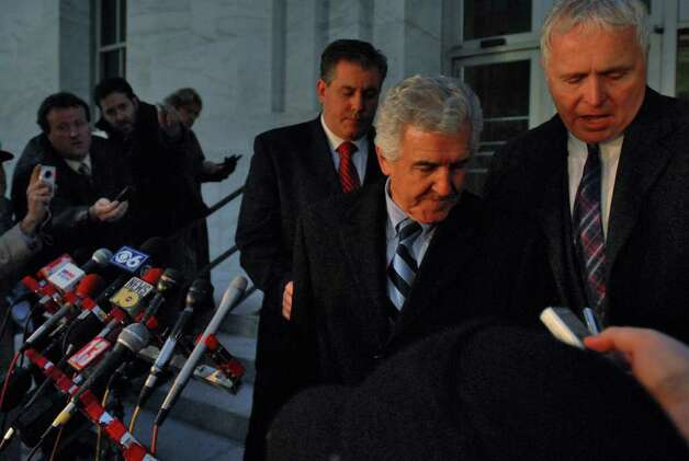 Former State Senate Majority Leader Joseph Bruno was found guilty on two of eight federal counts against him, as he leaves the front of the Federal Courthouse following the reading of the verdict in Albany, NY Monday evening December 7, 2009. Escorting him are his son  Ken Bruno, left, and spokesperson Kris Thompson, right. He spoke to the media briefly after emerging from the courthouse. (Philip Kamrass /  Times Union) Photo: PHILIP KAMRASS / 00006724A