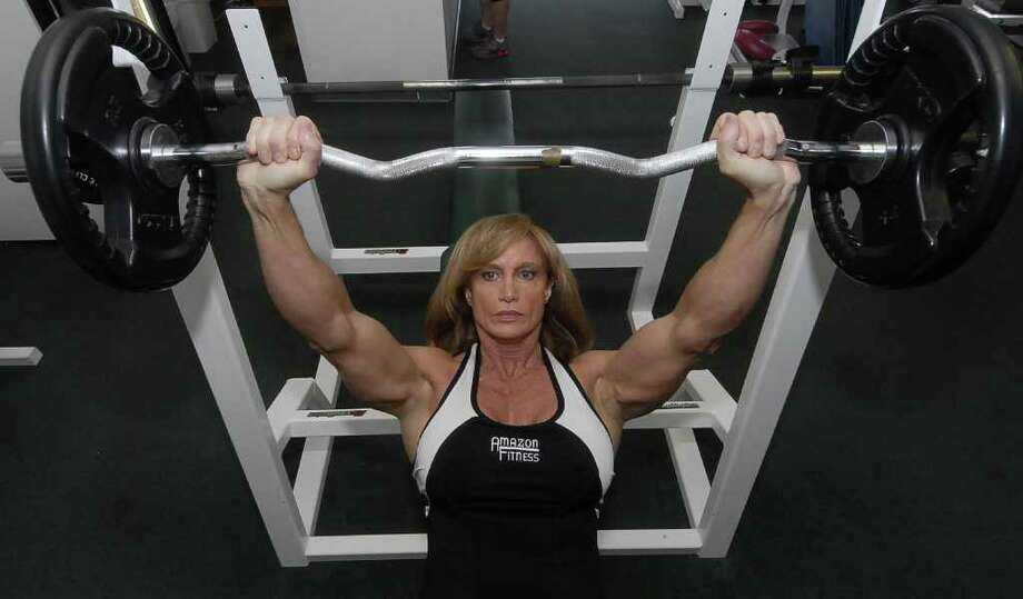 Pam Franklin works out on the incline bench press at her Amazon Fitness and Wellness Center Saturday 9/10/11. Photo by Tony Bullard. Photo: Tony Bullard / Credit: for the Chronicle