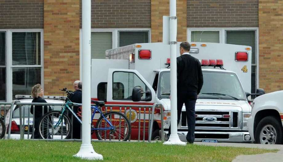 A Troy ambulance prepares to head to a local hospital with a patient who fell 45 feet from the roof of Knickerbacker Middle School in Lansingburgh on Wednesday, Nov. 16, 2011.  (Skip Dickstein / Times Union) Photo: SKIP DICKSTEIN / 2011