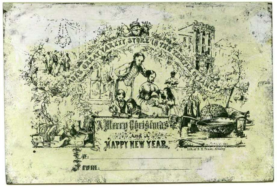 """America's First Christmas Card Designed and printed by Richard H. Pease for his """"Pease's Great Variety Store in the Temple of Fancy"""" c. 1851 Lithograph on heavy paper Image courtesy of Manchester Metropolitan University Special Collections"""