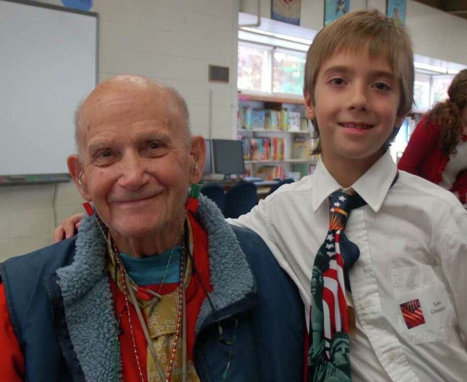 "U.S. Navy Air Corps Veteran Frederick ""Fritz"" Gleason and his grandson Sam Gleason enjoy the veteran's reception held in the Hindley School library following the program. Photo: Contributed Photo"