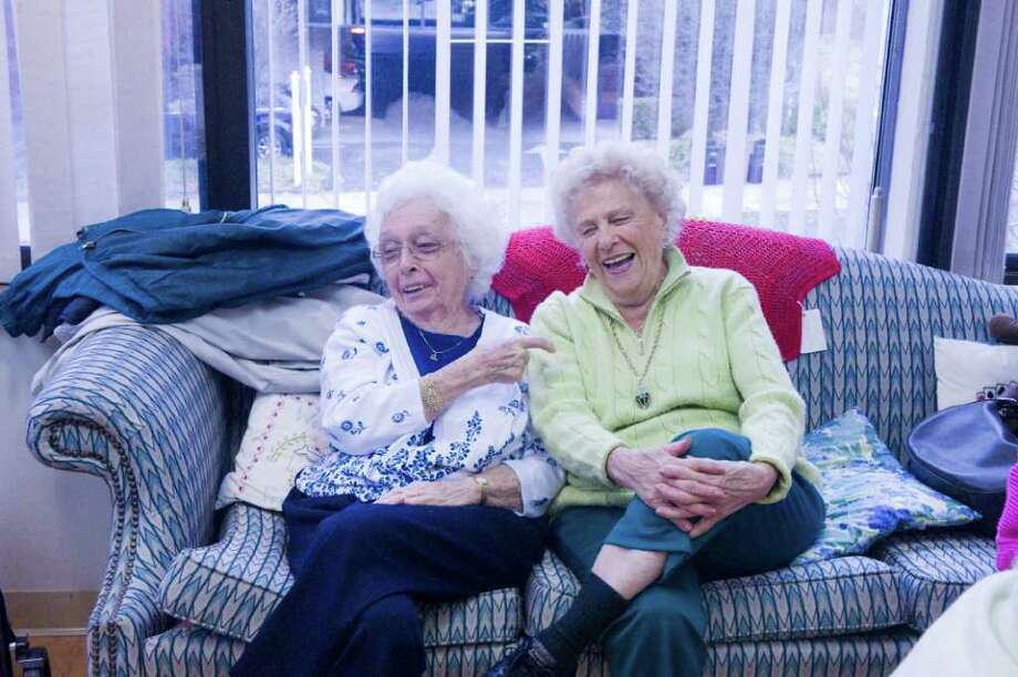 """Sisters Kay Walters, 92, left, and Fran Salvatore, 89, share a laugh while spending the day with the """"Over 60 Club"""" at the Senior Services of Stamford headquarters on Summer Street in Stamford, Conn., November 16, 2011. The club, which consists of 120 active members, is looking for a new home and someone to partner with Senior Services in sponsoring the group. Photo: Keelin Daly / Stamford Advocate"""
