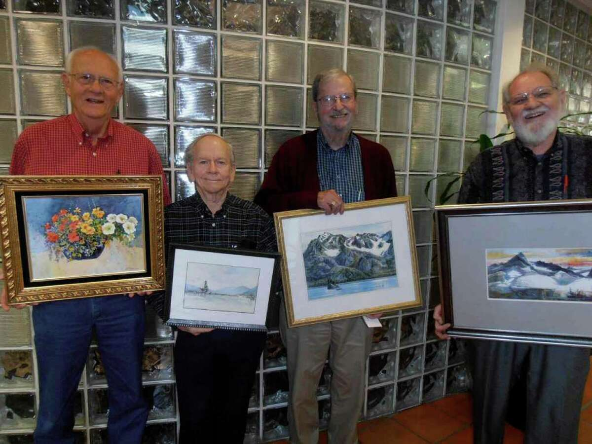 Lee Ricks, from left, Clay McGaughy, E. Gordon West and Finis Collins shows samples of their work at the San Antonio Board of Realtors.