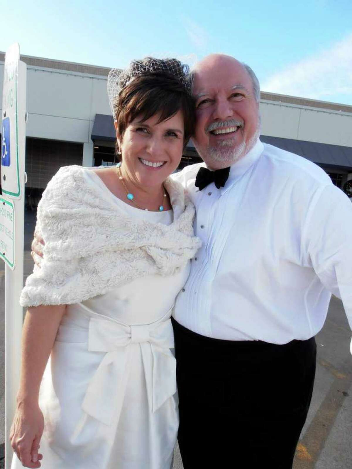 Lisa Petroski and Charles John, who wed at 11:11 a.m. on 11-11-11, run their first errand as husband and wife.