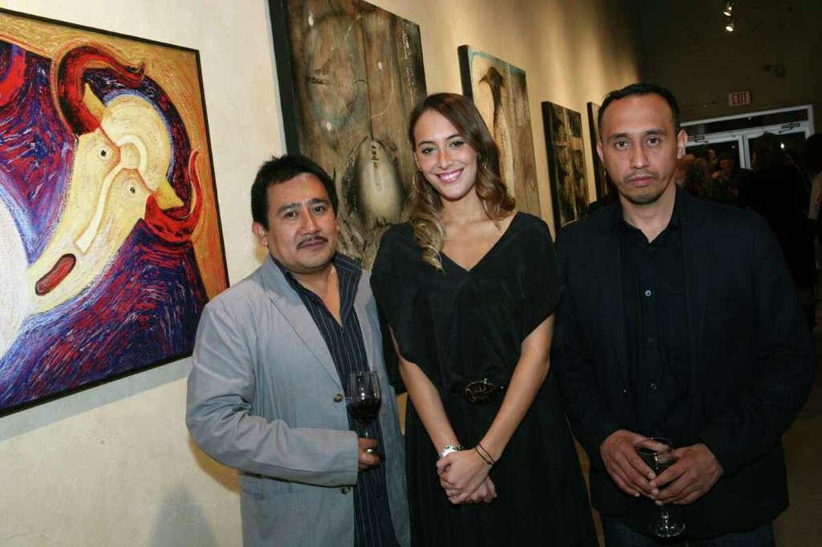 Rolando Rojas, left, Daniela Sacramento and Amador Montes attend the opening reception for