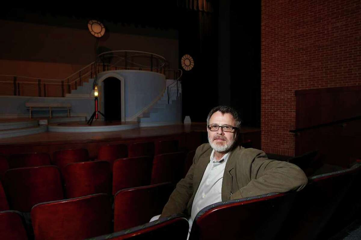 Trinity University Professor of Theatre Steve Gilliam sits before the set of