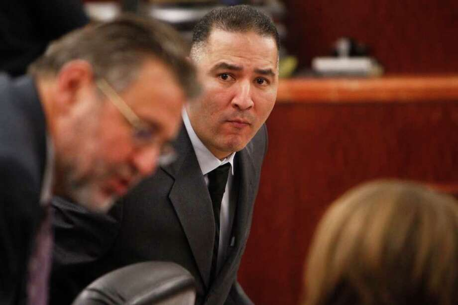 "Gregory Longoria Jr. takes his seat as he looks at his lawyers Stanley Schneider (left) and Casie Gotro (right) during opening arguments of his trial in the 185th State District Court at the Harris County Criminal Courthouse, Thursday, Nov. 10, 2011, in Houston.   Gregory Longoria Jr. is accused of tying a woman to a bed and using a can of hair spray and a cigarette lighter to burn her breasts and genitals, in addition to mutilating her body over a 17-hour period in February, according to court records.   Harris County Sheriff Adrian Garcia called Longoria a ""rabid dog"" during a press conference in which sheriff's investigators said the attack is one of the most horrific domestic violence crimes they had ever seen.  ( Michael Paulsen / Houston Chronicle ) Photo: Michael Paulsen / © 2011 Houston Chronicle"
