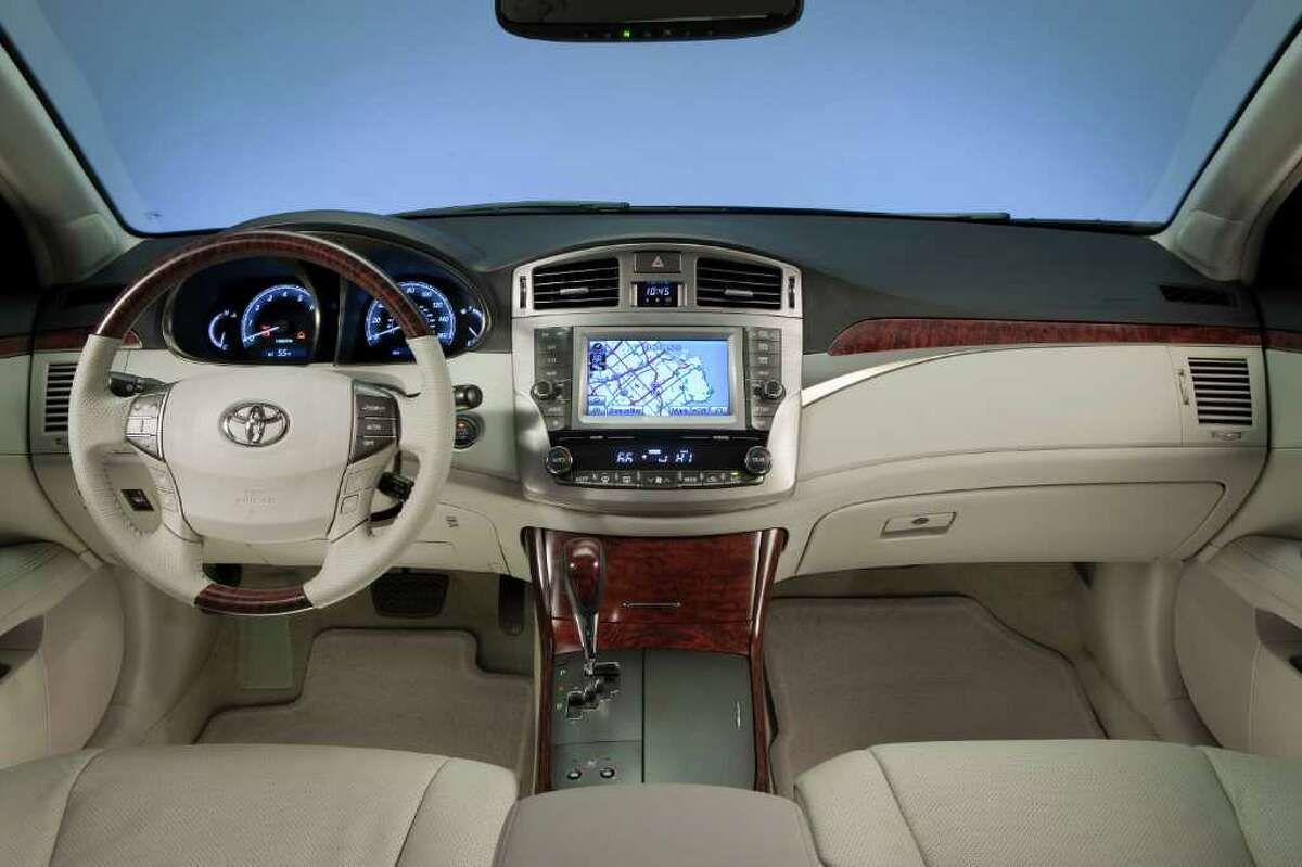 Leather upholstery and faux wood-grain interior trim are standard on the 2012 Toyota Avalon. The navigation system is optional. COURTESY OF TOYOTA MOTOR SALES U.S.A.