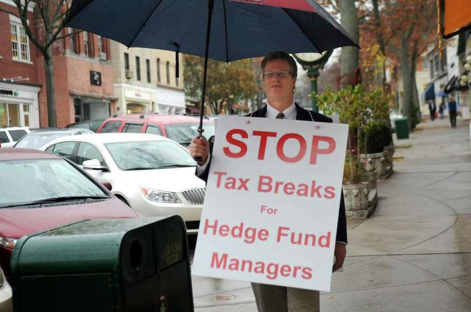 Daniel Barach of Mamaroneck, N.Y., a portfolio manager consultant, walks up and down Greenwich Avenue Wednesday afternoon Nov. 16, 2011, to protest hedge funds. Photo: Helen Neafsey / Greenwich Time