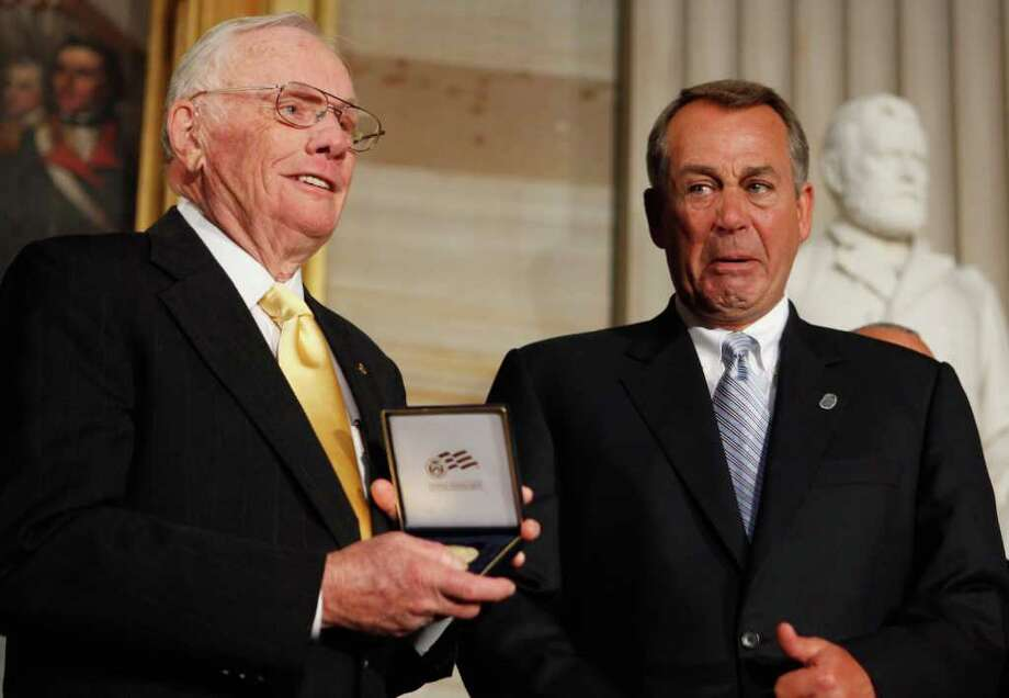 WASHINGTON, DC - NOVEMBER 16:  Astronaut Neil Armstrong (L) recievces the Congressional Gold Medal from Speaker of the House John Boehner (R-OH) during a ceremony in the Rotunda of the U.S. Capitol November 16, 2011 in Washington, DC. The gold medals were presented to Armstrong and his fellow crew members from Apollo 11, Michael Collins and Buzz Aldrin, and to astronaut and former U.S. Senator John Glenn (D-OH), the first American to orbit the Earth.  (Photo by Chip Somodevilla/Getty Images) Photo: Chip Somodevilla, AP And Getty / 2011 Getty Images