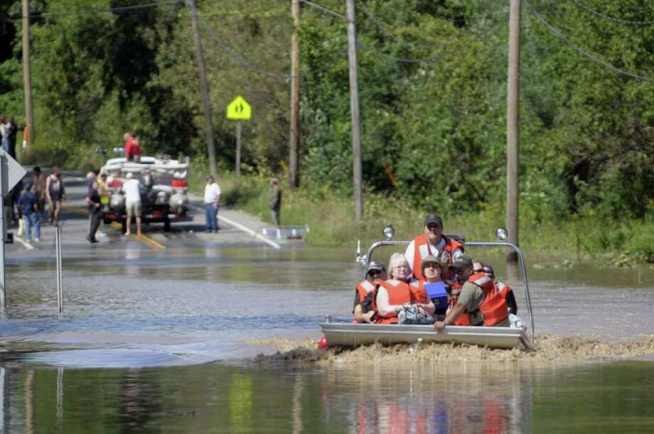 Area firefighters use a boat to evacuate residents of Rotterdam Junction on Monday, Aug. 29, 2011 due to rising flood waters of the Mohawk River.   (Paul Buckowski / Times Union) Photo: Paul Buckowski / 00014438B