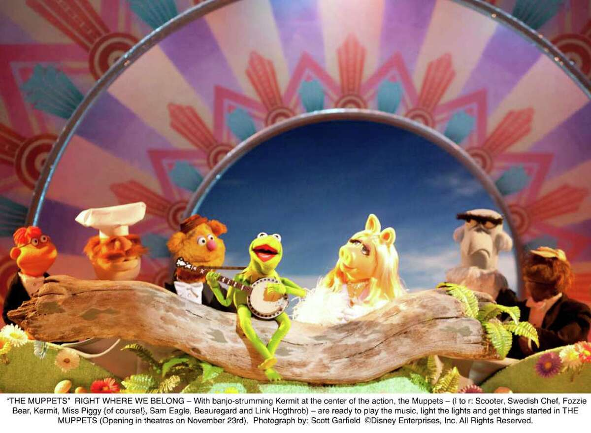 With banjo-strumming Kermit at the center of the action, the Muppets are ready to play the music, light the lights and get things started again.