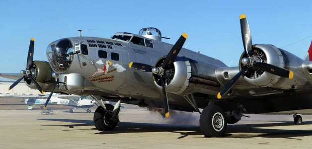 "Smoke belches out of the B-17 bomber ""Aluminum Overcast"" as its engines are cranked up Wednesday before taking off at Louis Schreiner Field in Kerrville, Texas. Operated by the Experimental Aircraft Association (or EAA) in Wisconsin, the plane is on tour and its next stop is in Houston.  (Wednesday November 16, 2011) JOHN DAVENPORT/jdavenport@express-news.net Photo: SAN ANTONIO EXPRESS-NEWS"